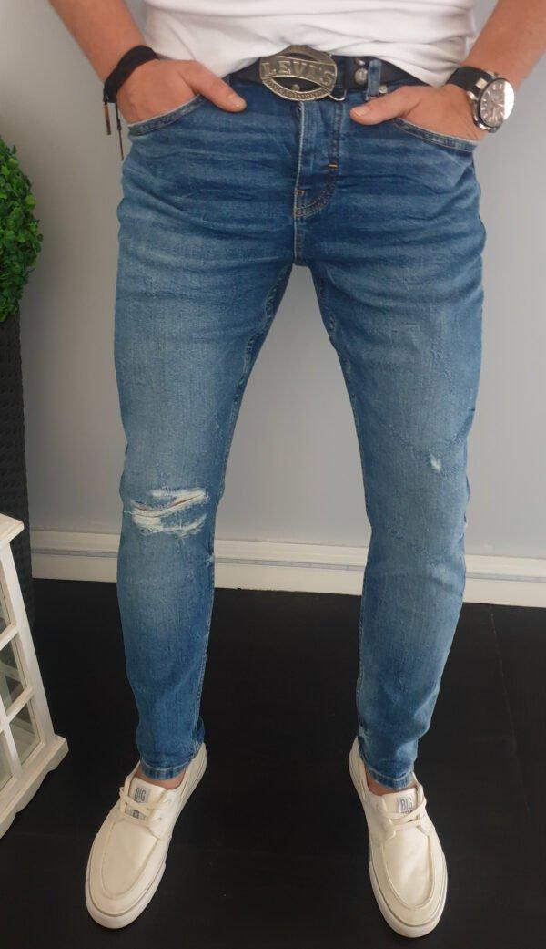 Spodnie męskie jeansy z dziurami