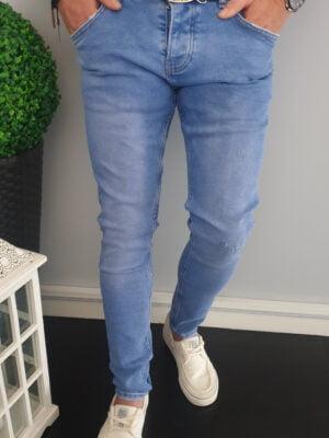 Niebieskie spodnie jeansowe męskie