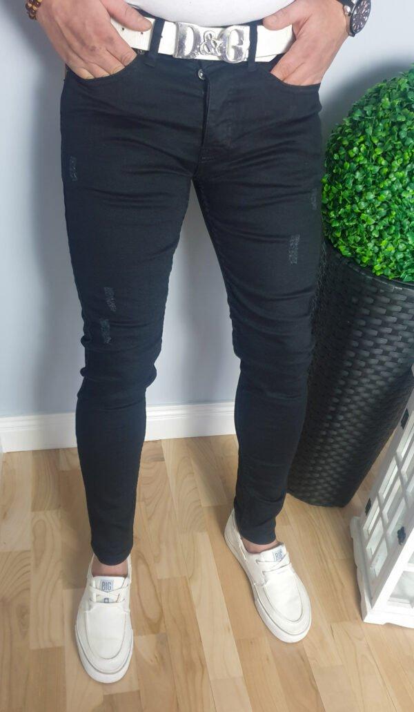 Czarne spodnie jeansowe męskie z przetarciami